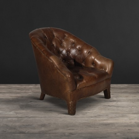 Branco chair shown in Old Saddle Nut leather