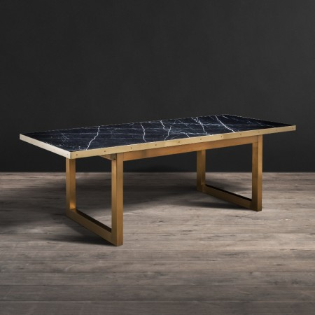 Colosseum dining table shown in Black Marble Polished & Shiny Brass