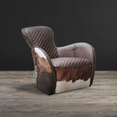 Saddle chair shown in Matador Nuez with Brown & White Moo